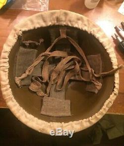 Scarce WWII Imperial Army Japanese helmet with original canvas cover